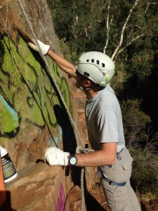 Cleaning the graffiti off cliffs at Onkaparinga
